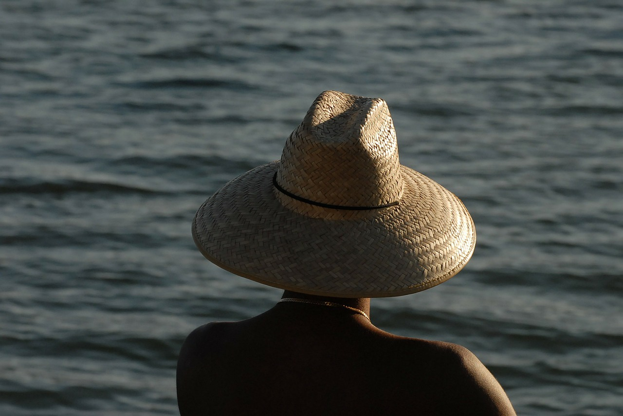 CC0 Public Domain http://pixabay.com/en/straw-hat-man-sea-sunlight-sunset-70696/